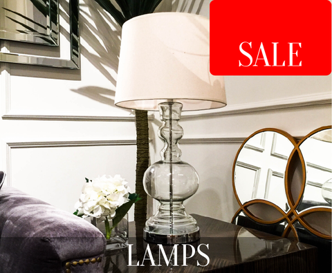Modern classic and timeless table lamps display in a living room with mirror, side table and sofa.