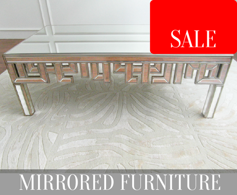 Mirrored coffee table with oriental hand-cut mirror designs on Candice Olson rug on sale in Singapore.