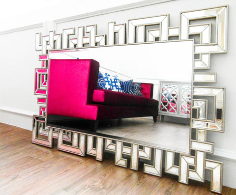 Decorative wall mirror with geometric patterns