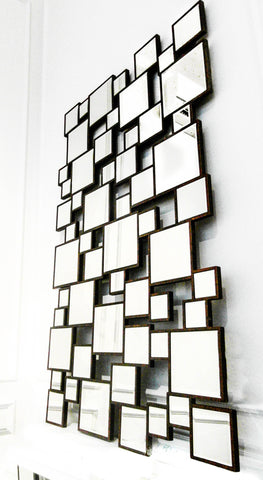 Mirror hung on wall with geometric patterns