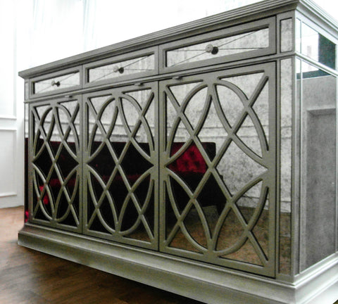 Displayed in Singapore showroom, this antique vintage mirrored credenza with red sofa reflection and middle swivel door is perfect for liquor, spirits, and bottled wines