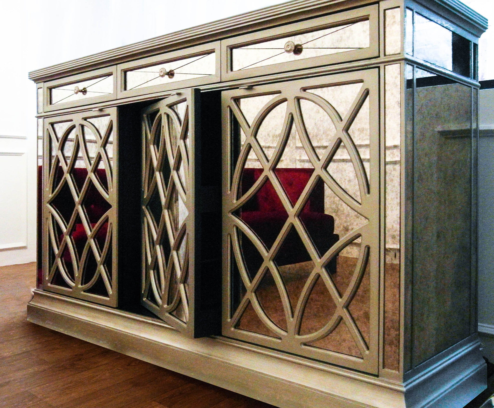 the old world charm mirrored credenza  finnavenuecom – finn avenue -  antique vintage mirrored credenza with red sofa reflection and middleswivel door that is perfect for