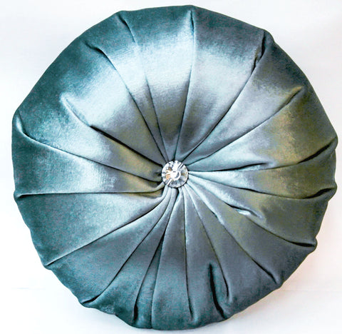 Blue satin round cushion is perfect for any condo showrooms or private homes as a home decor idea.