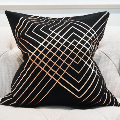 Black cushion with rose gold designs