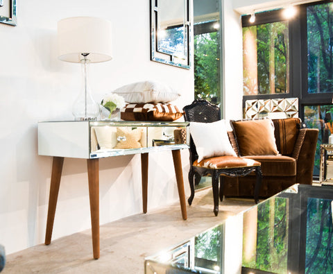 Finn Avenue's Nord Mirrored Console Table with angled wooden legs is one of the most unique piece of furniture sold in Singapore.