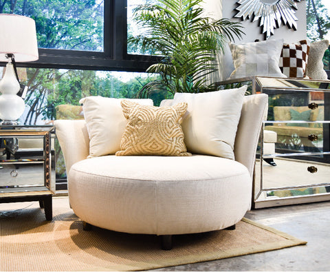 Finn Avenue's round loveseat sofa in beige fabric and comes with two large cushions displayed at APEX@Henderson gallery.