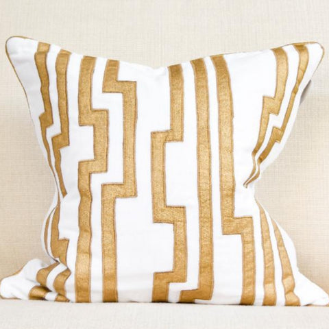 Candice Olson's gold and white modern classic cushion on beige sofa.