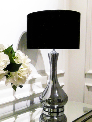 A sleek fluted quartz-like glass lamp base that contrasts with black drum shade and metal accented foot, finial, and neck totally creates a visually-striking touch using Singapore voltage 110V-240v AC. E27. LED bulb free.