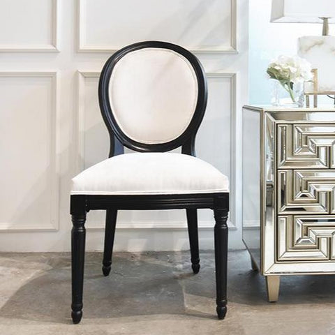 King Louis dining chair with white velvet upholstery and black wood finish. Available at Finn Avenue Singapore, a luxury online home furniture and home decor shop with express delivery.