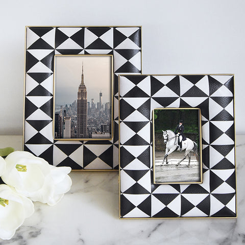 Photo frames in black and white fretwork design