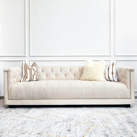 Chesterfield sofa sets the mood with a variety of quality cushions in Singapore.