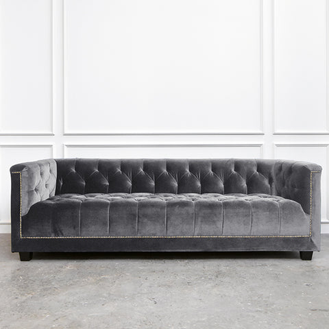 Chesterfield sofa that is tailor-made and customized into grey velvet from a variety of fabrics to choose from.