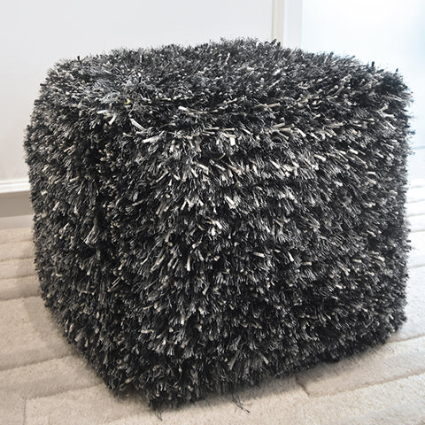Pouf & Stool - Coal Black and White Sand Stool not just functions as a seat but also as a decor accessory in the living room.