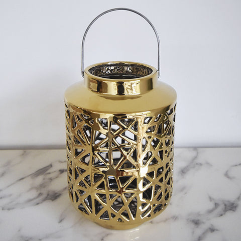 Emiliano Gold Decorative Lantern - Style this gold sculptural lantern to your bar counter, entryway console, table art, or bookshelf decor for a touch modern vintage luxe.