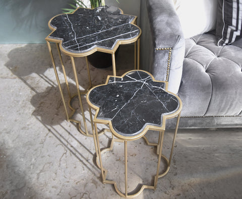 Gold black marble nesting end tables in Singapore condo showroom display.