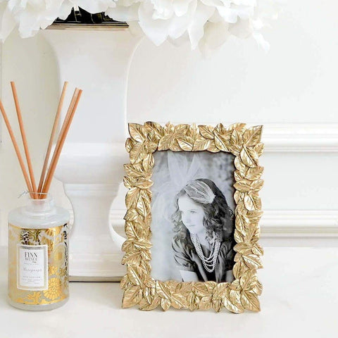Pachira Gold Leaves Photo Frame in Living Room Deco Ideas