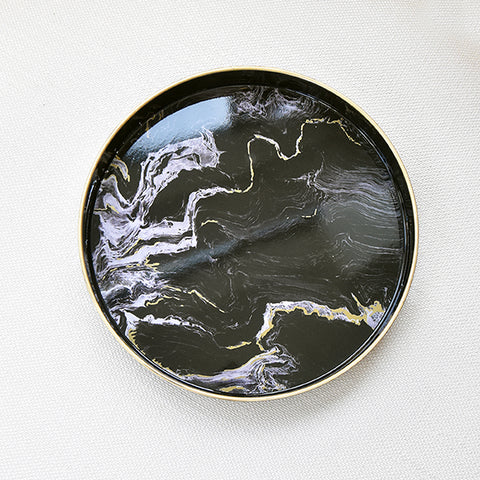 Black Marbled Tray, Round is displayed at Finn Avenue Furniture & Home Accessories Online Store & Showroom in Singapore