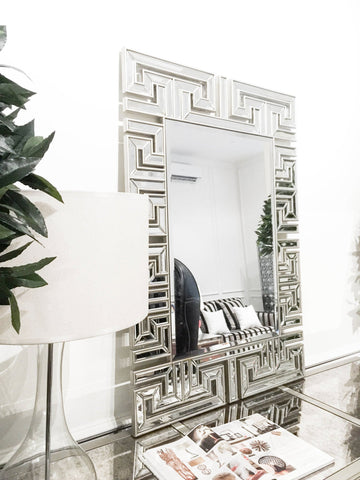 Tradition Reinterpreted Handcarved Mirror with small bevelled mirrors on the periphery creates a reinterpretation of modernity and tradition, and is displayed in Singapore showroom.
