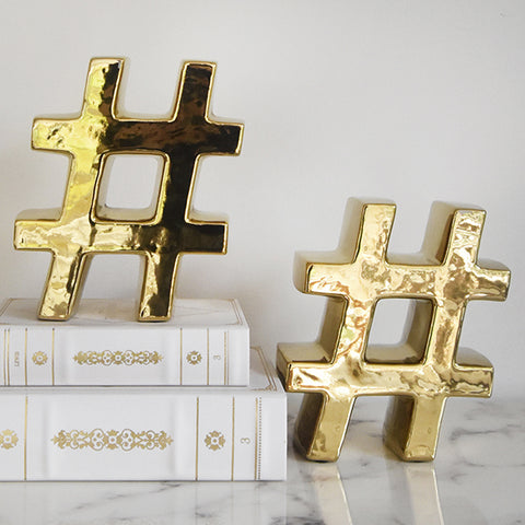 Style this gold symbol bookend to your bookshelf or table decor for a unique individual style.