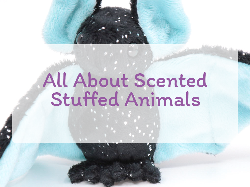 "The text ""All About Scented Stuffed Animals"" on a 50% white background on top of an image of a black and sparkle bat with light blue inner wings and ears."