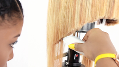 breanna cutting a blonde bob with peanut clippers