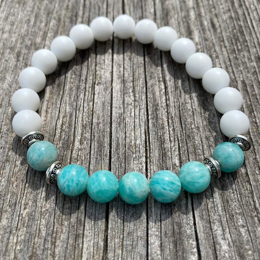 White jade round gemstones with a amazonite stone which is aqua coloured with pretty silver spacers bracelet