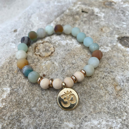 gemstone bracelet with yoga OM charm