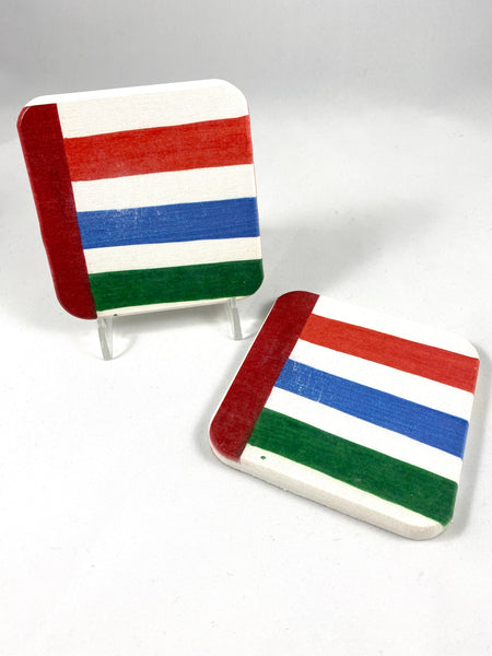 Coasters with red blue and green stripes