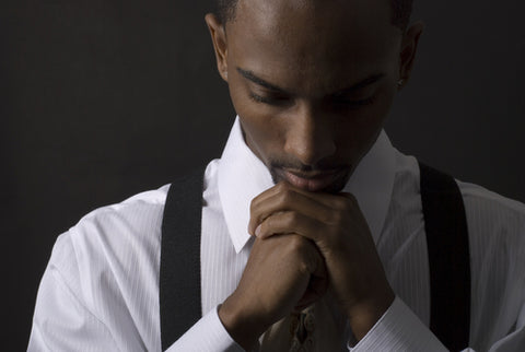 Young African American man praying