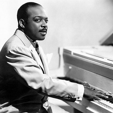 Count Basie at a piano