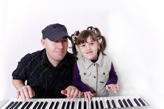 Dad & daughter improvising on piano