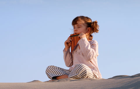 Girl playing bamboo flute