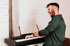 Man singing & playing piano