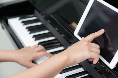 piano practicing with tablet