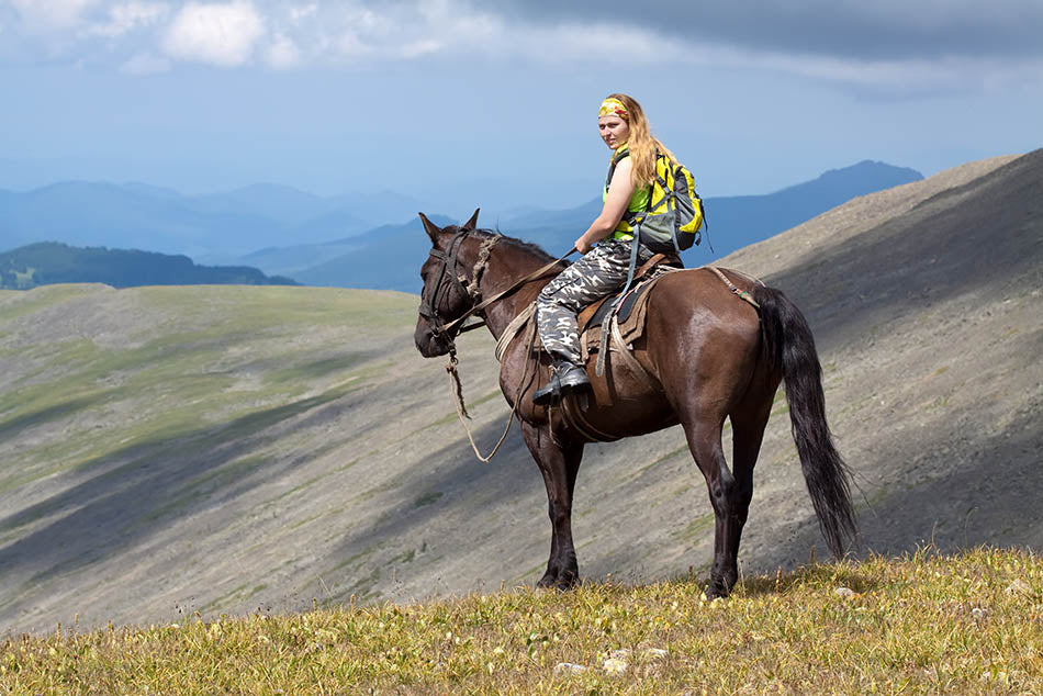 Woman on a horse in the mountain
