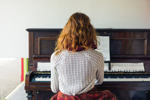 Young woman practicing piano