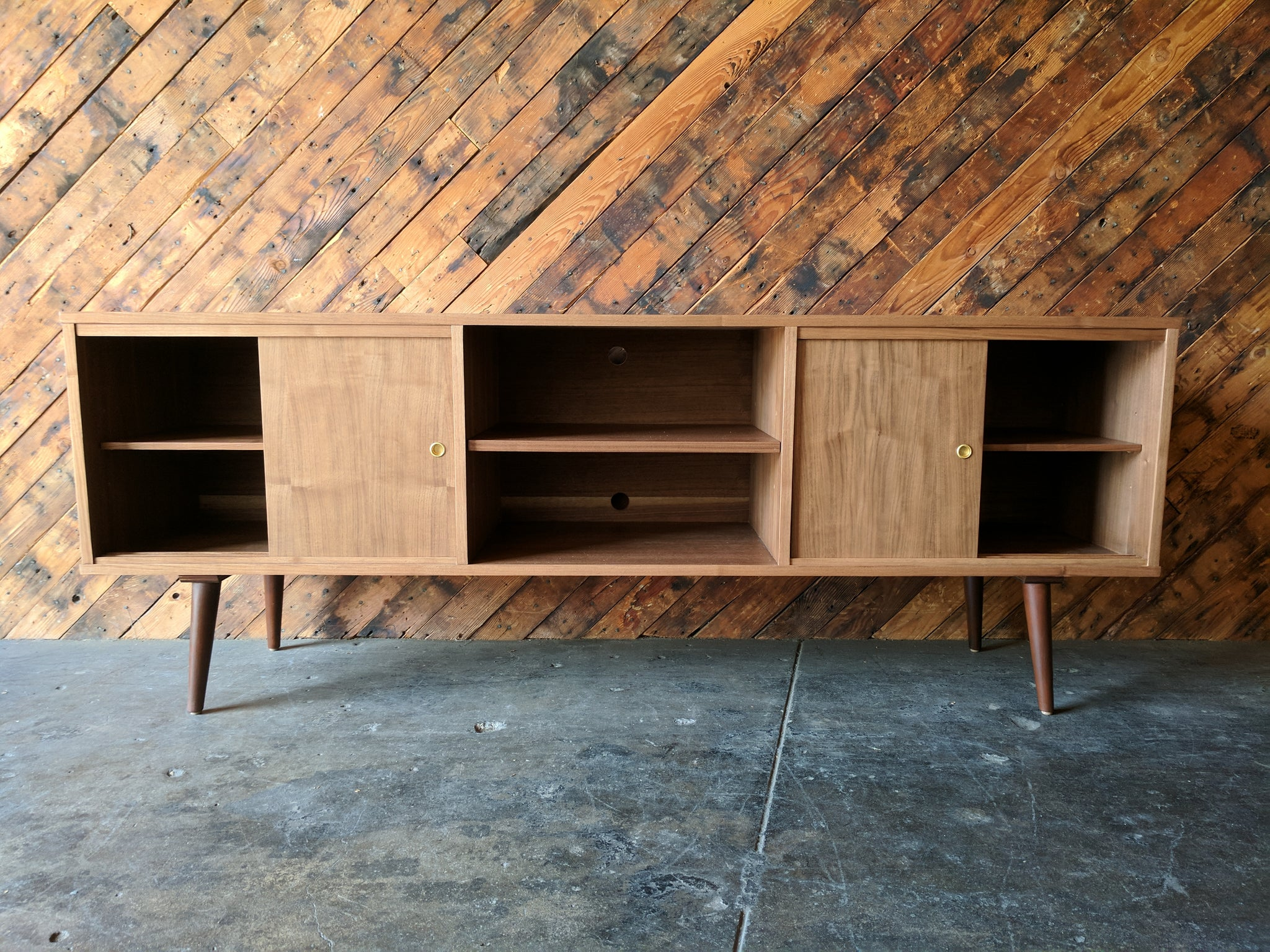 CUSTOM MID CENTURY STYLE WALNUT CREDENZA with 3 bays and 4 sliding doors