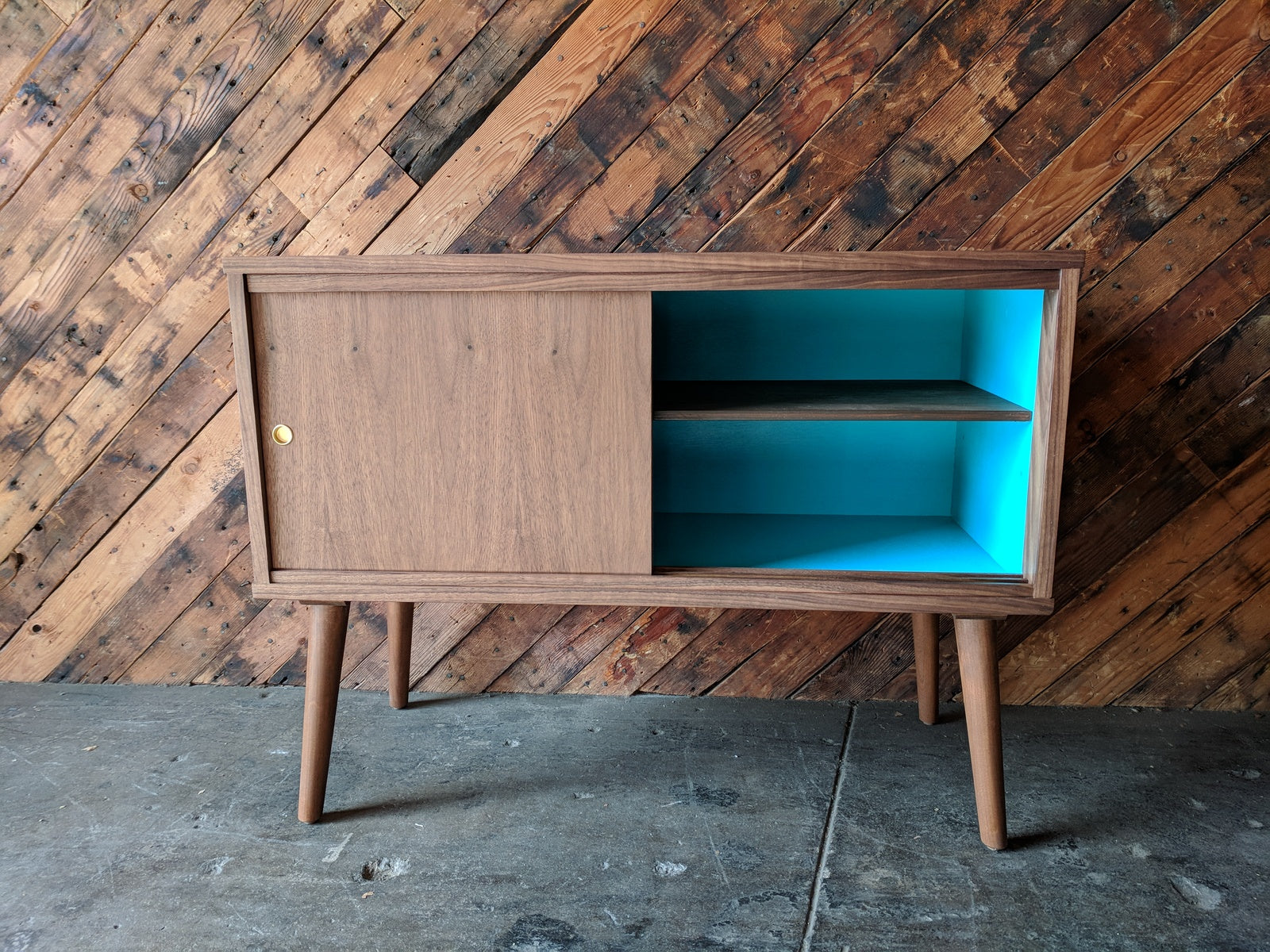 Custom Mid Century Style Walnut Cabinet with painted interior and sliding doors