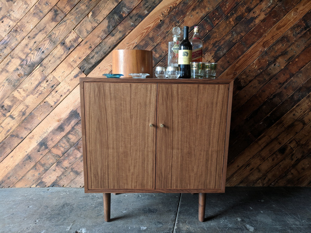 Mid Century Style Walnut Bar/Cabinet with swing out doors and brass knobs
