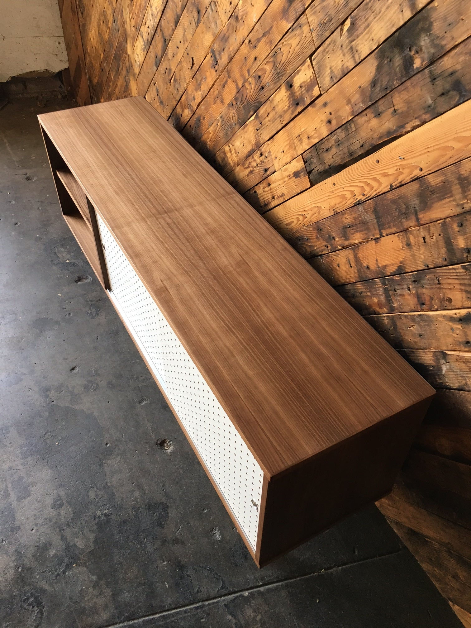 Custom Walnut credenza with perforated doors and metal track, Mid Century Style