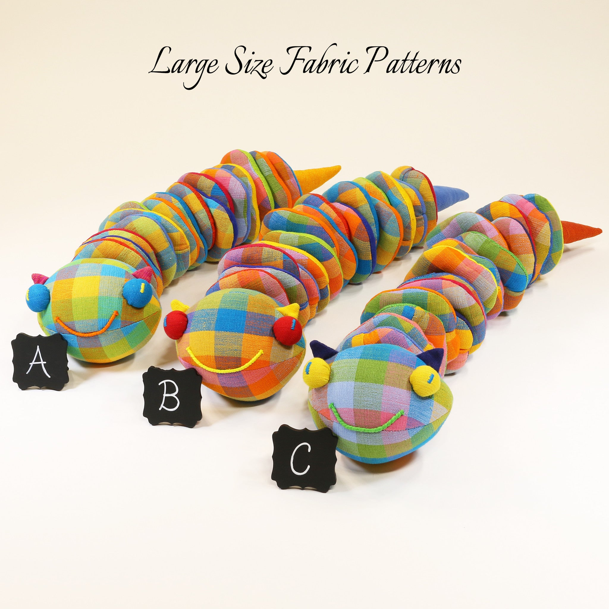 Casey, the Caterpillar – large size fabric patterns shown