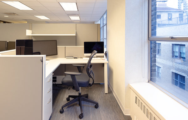 By lowering the height of the existing panels, work areas have much more light