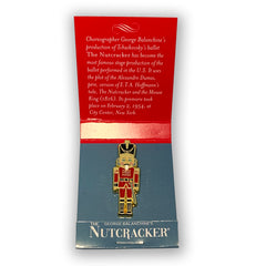 Nutcracker Pin in Open Matchbook Style Packaging