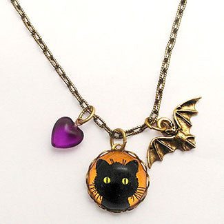 Green Eyed Black Cat with Bat Charm and Purple Heart Bead Necklace