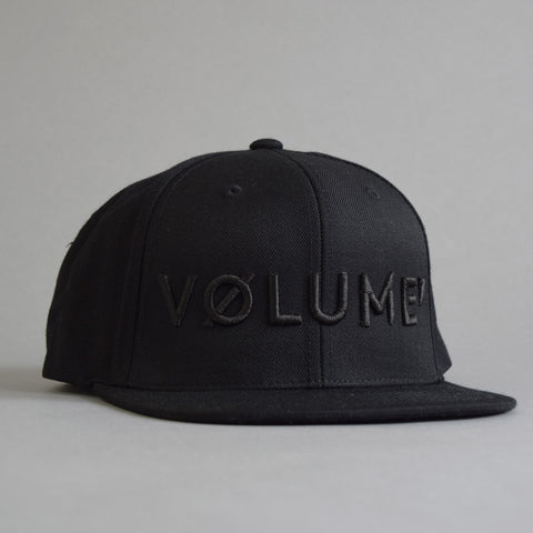 Volume One Black on Black Snapback Hat