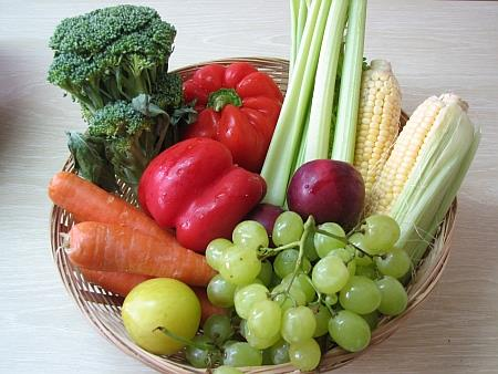 Fruits and vegetables in wicker bowl
