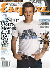 ewan mcgregor on the front of esquire magazine wearing th han cholo Han solo blaster belt buckle
