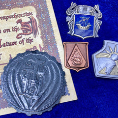 the soul coin and various other badges from Beadle and Grimms