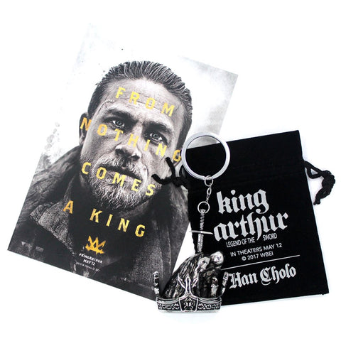 SHOT OF THE KING ARTHUR LEGEND OF THE SWORD PROMO POST CARD, KEYCHAIN WITH CUSTOM VELVET POUCH.