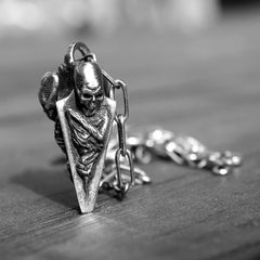 black and white photo of the death spike pendant from the han cholo court of the dead line